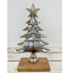 A chic silver layered Christmas tree decoration with a star topper. Set upon a chunky wooden base