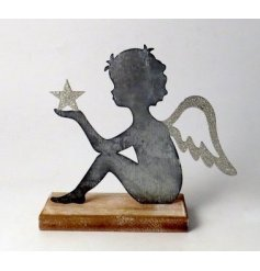 A Rustic Living inspired decoration, set with a Cherub shaped metal feature