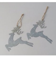 A charmingly simple hanging reindeer decoration made from cut metal and hung from a jute string