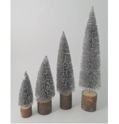 A standing metal bristle tree set on a bark base