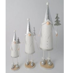 this standing metal Santa decoration in a silver and white tone will be sure to tie in with any Winter Wonderland themed