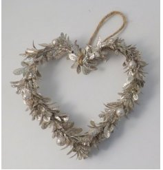 A simple yet stylish hanging glittery wreath set with a champagne tone and heart shape