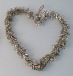 A champagne toned heart wreath made up of mistletoe leaves