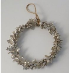 A champagne toned wreath made up of mistletoe leaves