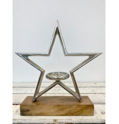 Stay on trend with this chic rough luxe star shaped t-light holder with chunky wooden base.