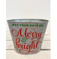 A chic rustic metal planter with a red glitter Merry and Bright slogan. Complete with a holly motif.