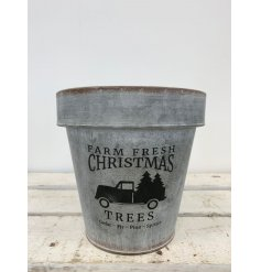 A stylish metal planter with a Farm Fresh Christmas slogan.