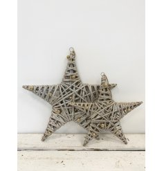 A chic wicker star decoration with a glitter finish and miniature gold baubles.