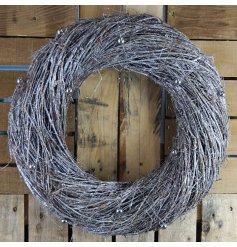 A chunky rustic twig wreath with plenty of sparkle and miniature baubles.