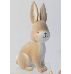 An adorable little posed bunny rabbit decoration, set with a fuzzy fur coating and cute smile