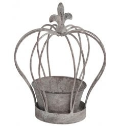 A distressed metal crown planter. Just add a plant or flowers for the perfect centre piece.