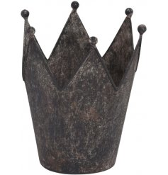 A rustic metal crown perfect to use as a planter or candle holder.