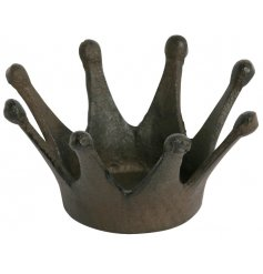 Set with a distressed inspired decal, this small cast iron crown will make a perfect little tlight holder