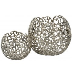 A stylish set of assorted sized bowls featuring a silver luxe tone and squiggle like patterns