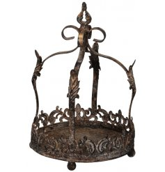 An overly distressed metal crown with added cut decals and patterns,