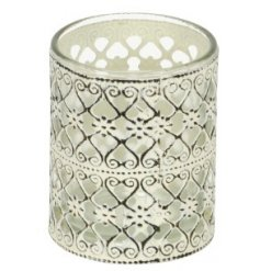 A small sized metal candle pot featuring an overly distressed cream tone and added laser cut decals and patters