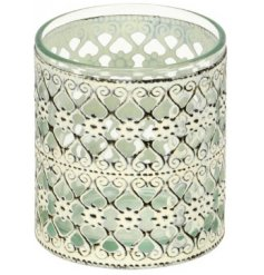 Set with a shabby chic inspired decal, this metal cut candle holder will be sure to place perfectly in any themed home
