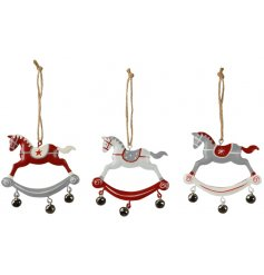 A festive themed assortment of hanging metal rocking horse decorations