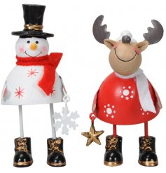 An assortment of festive themed standing metal characters, perfectly set with Traditional colours and decorations
