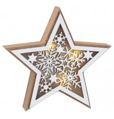 A natural wooden free standing star with added white trimmings, cut snowflake decals and a warm glowing centre