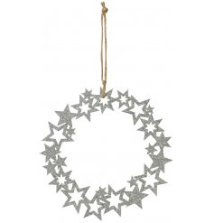 A round hanging wreath made up of assorted sized stars and covered in a sparkling silver glitter