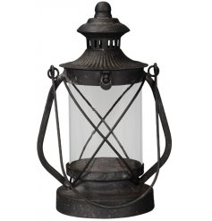 Bring a vintage charm to any interior with this black metal Lantern Candle Holder