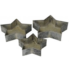 Bring a rustic charm to any home space with this set of 3 metal star trays