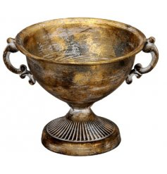this large metal urn will be sure to place perfectly in any home space
