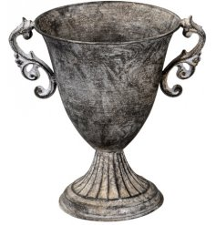 Bring a distressed charm to any home space with this Luxe inspired metal urn