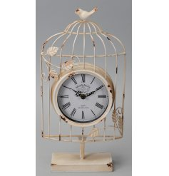 An overly distressed clock with a cream tone and added bird cage inspired decal