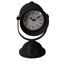 A vintage inspired standing metal clock featuring a rustic black tone and olden era face style