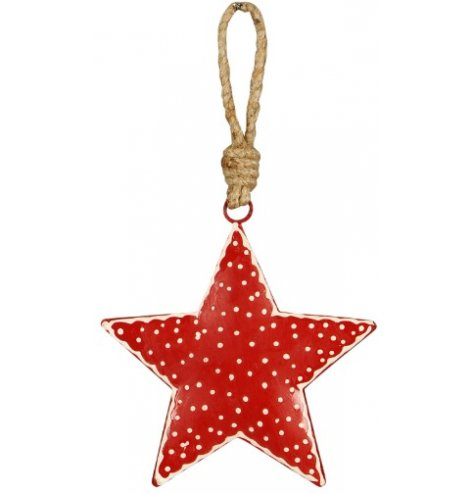 A nordic inspired, shabby chic metal star Christmas decoration with a polkadot pattern and chunky jute hanger.