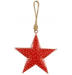 A hanging metal star with a red and white polka dot pattern,