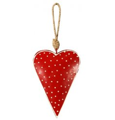 A hanging metal heart with a red and white polka dot pattern, a perfect accessory to add to any Nordic inspired display