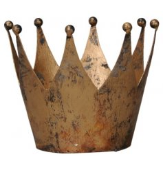 A rustic inspired metal crown set with a distressed golden tone