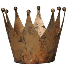 Set with an overly distressed feature, this metal crown decoration all displays a rustic golden tone