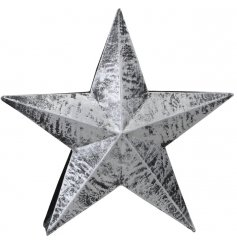 Bring a Rough Luxe trend to your home interior with this free standing metal star ornament