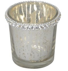 A charming frosted white toned candle holder featuring a mottled effect and added diamond trim decal