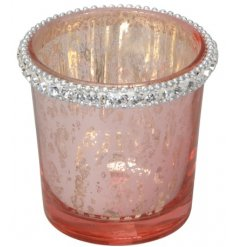 A charming blush pink toned candle holder featuring a mottled effect and added diamond trim decal