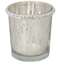 Bring a wintery touch to any home space with this small glass tlight holder