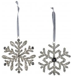 A beautiful assortment of hanging silver snowflakes set with individual patterns and beaded accents