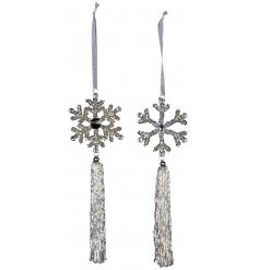 A beautiful assortment of hanging silver snowflakes set with individual patterns, beaded accents and tassels