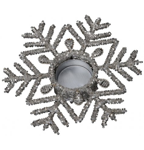 A shimmering beaded snowflake design t-light holder