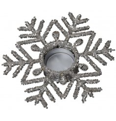 Bring a dazzling touch to any sideboard or dining table with this gorgeous silver snowflake candle holder