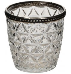 Bring a charmingly distressed vibe to your home interior with this small glass candle pot