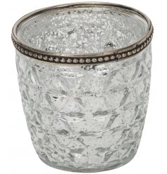 Bring a charmingly distressed vibe to your home interior with this tall glass candle pot