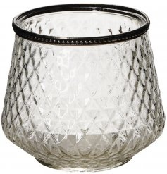 A beautifully simple clear glass candle holder featuring an added ridged decal and vintage metal rim
