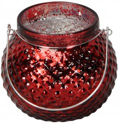 A small round ridged glass tlight holder set with a mottled silver centre and festive red tone