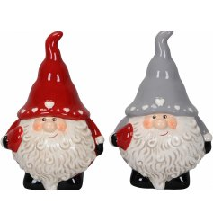 A cute mix of festive red and grey toned ceramic gonk figures,