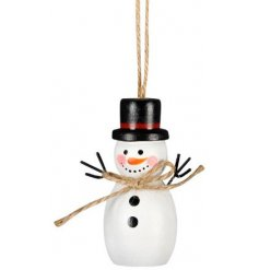 A white toned hanging wooden snowman perfectly topped with a festive red hat